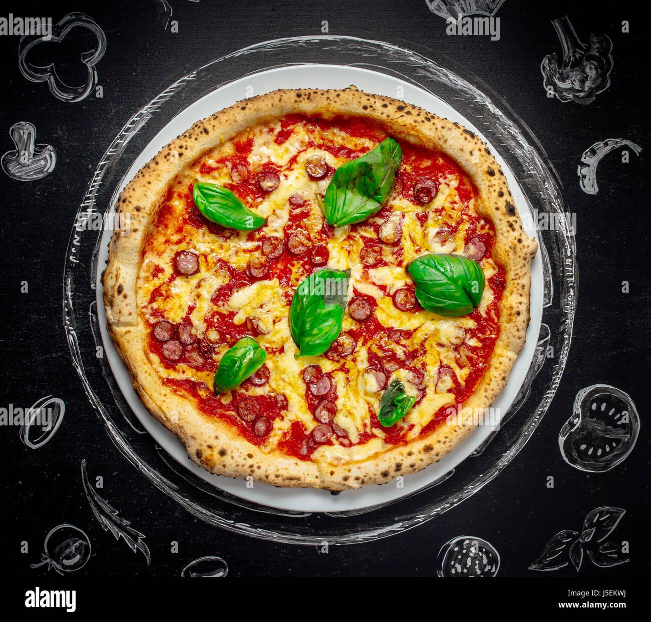 tasty Italian pizza with basil - Stock Image