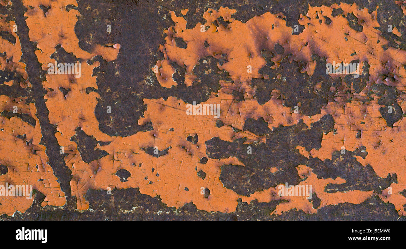 Rusty iron metal surface with orange paint. Texture and background - Stock Image
