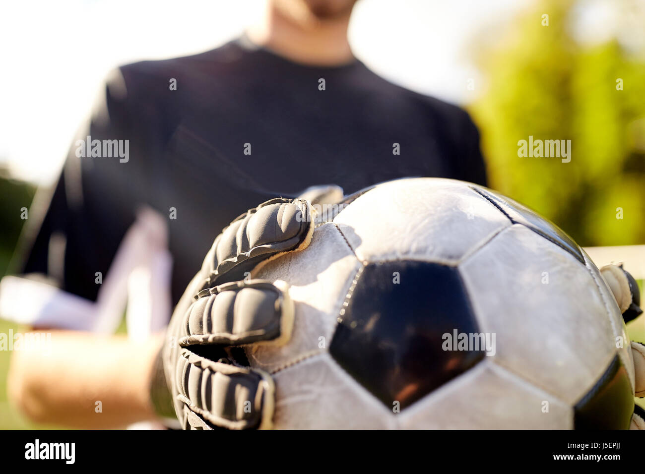 close up of goalkeeper with ball playing football - Stock Image