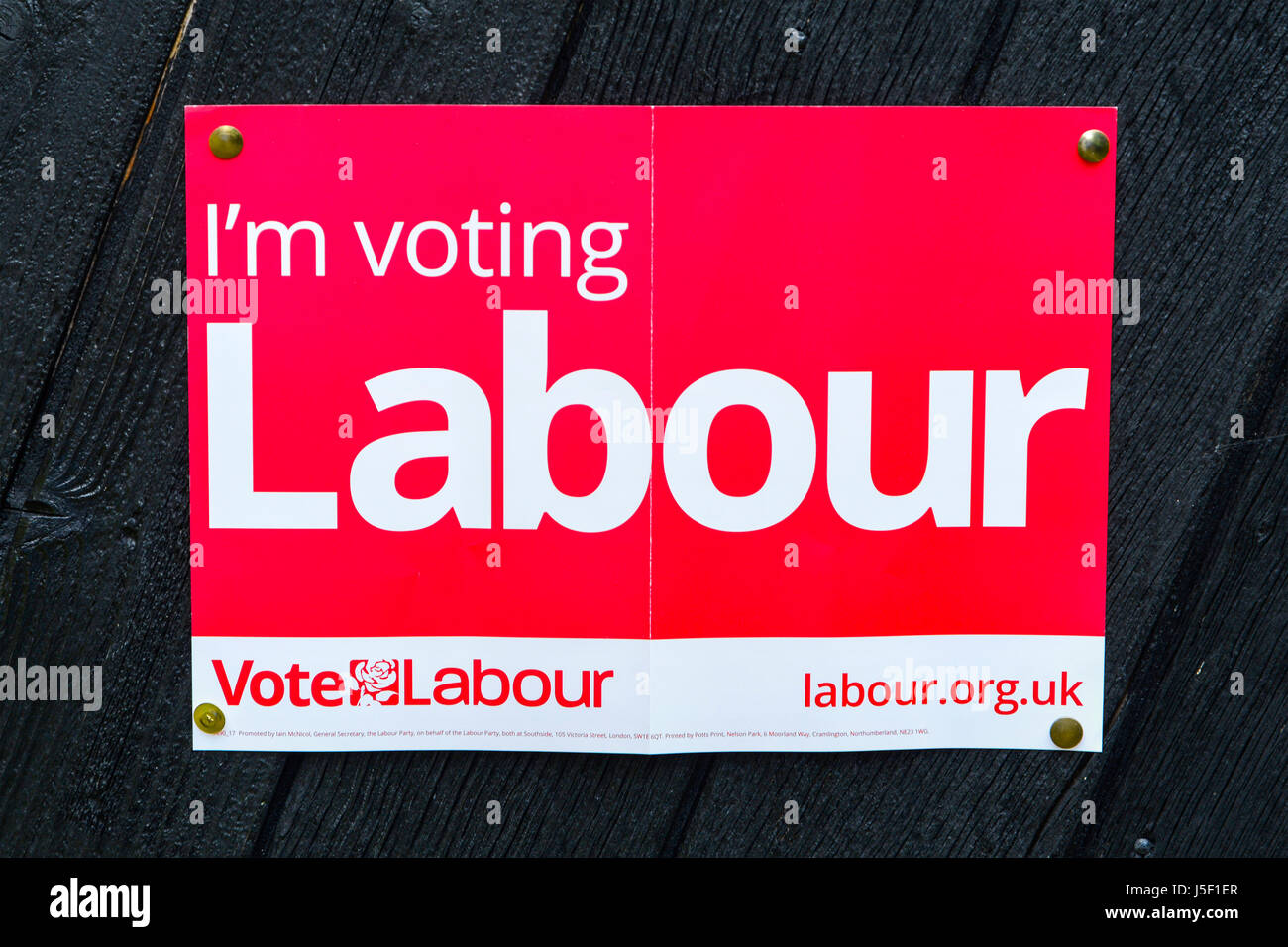 General Election 2017 - Vote Labour Poster Pinned to Door - Stock Image
