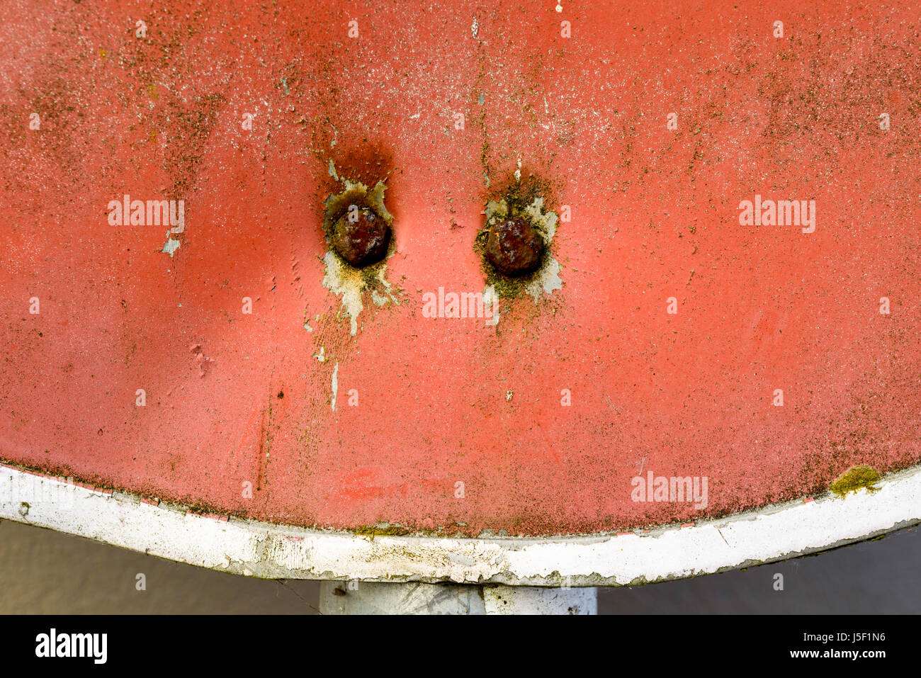 No Entry sign showing signs of fading and damage. Two retaining fastener are heavly corroded. - Stock Image