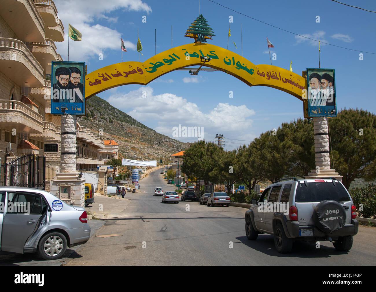 Gate depicting the Hezbollah and iranian leaders, Beqaa Governorate, Machghara, Lebanon - Stock Image