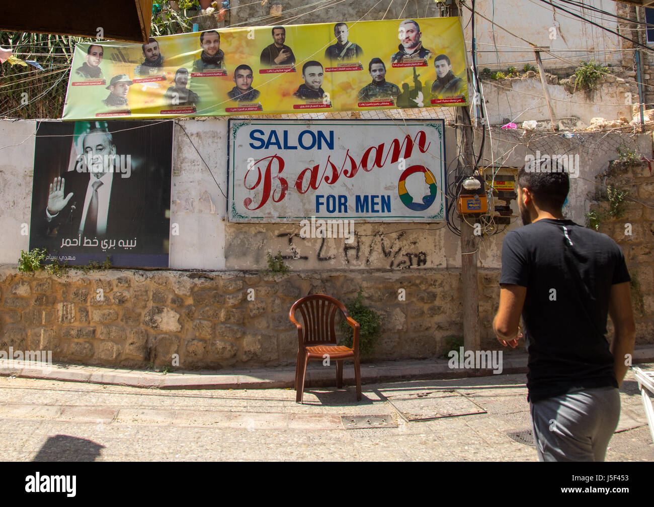 Hezbollah martyrs pictures on a wall, South Governorate, Tyre, Lebanon - Stock Image