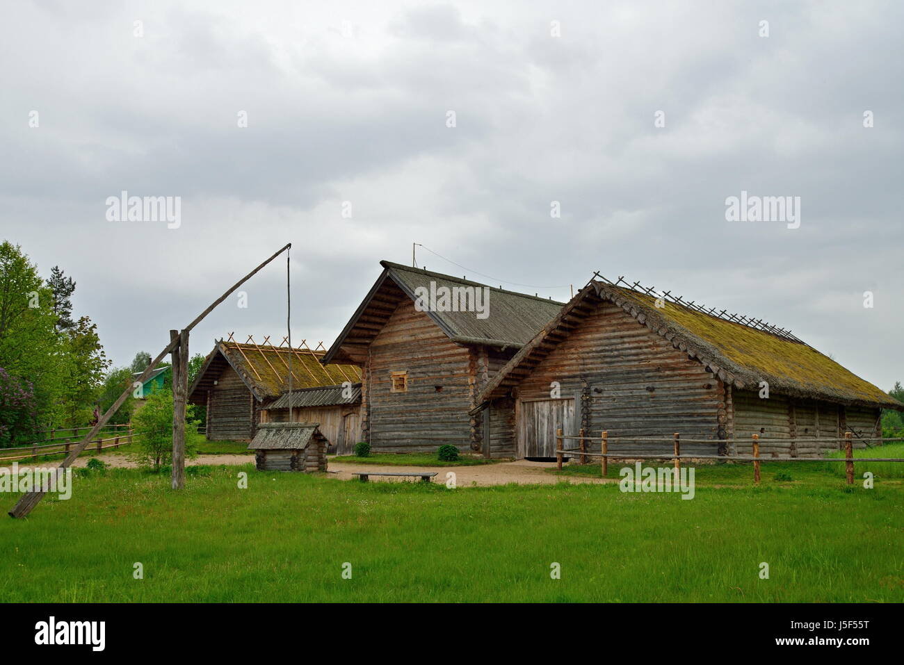 Old Russian log hut in Pushkin Mikhailovskoe summer cloudy day - Stock Image