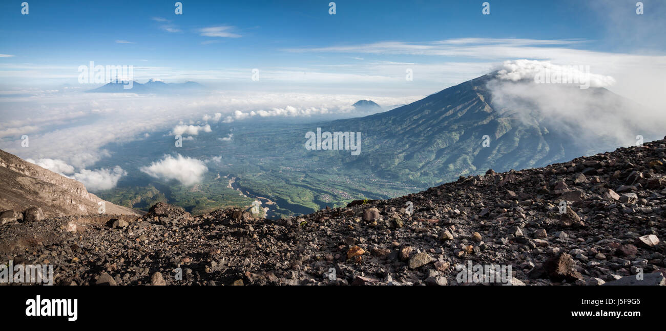 Sweeping panorama of the volcanic landscape viewed from Mount Merapi (Gunung Merapi) a high altitude volcano with - Stock Image