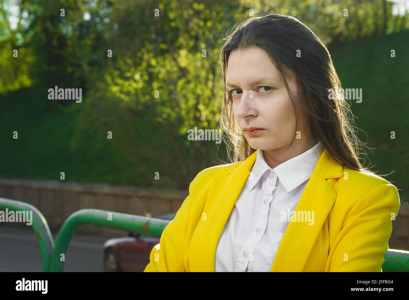 Young attractive woman in a bad mood - Stock Image