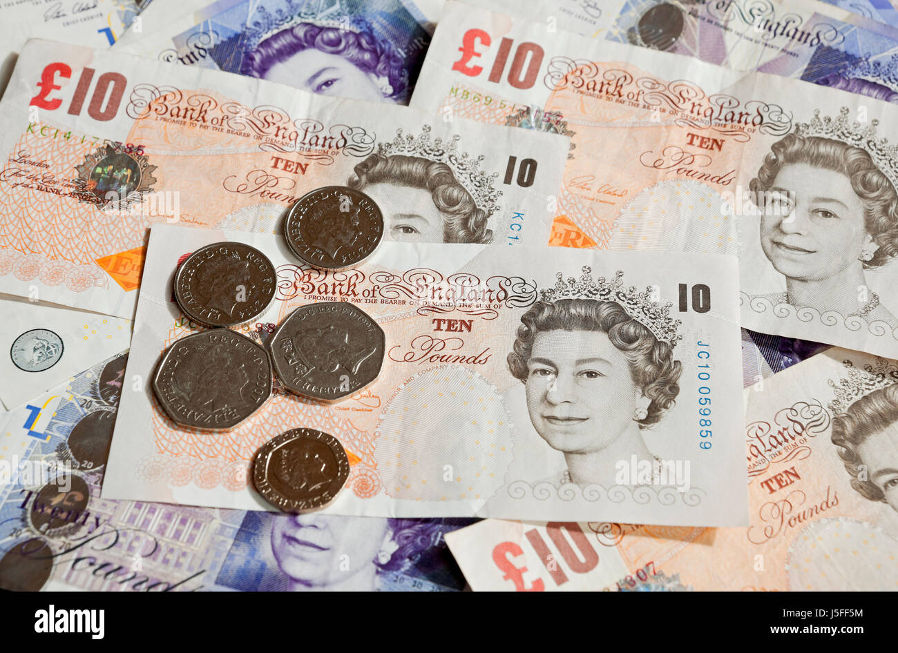 English ten and twenty pound notes and coins England UK United Kingdom GB Great Britain - Stock Image