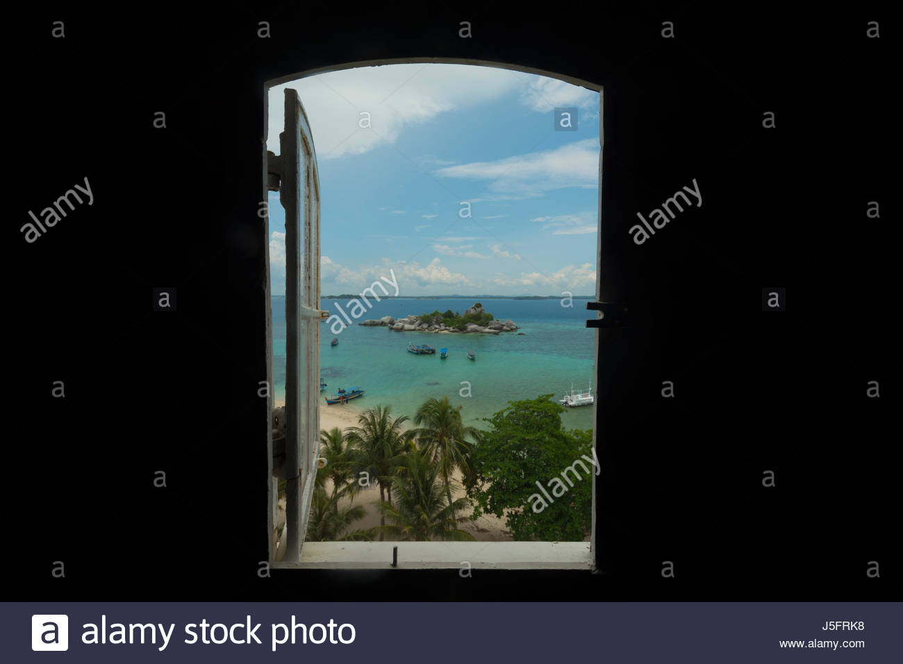 Window View From Lighthouse at Lengkuas Island, Indonesia Stock Photo