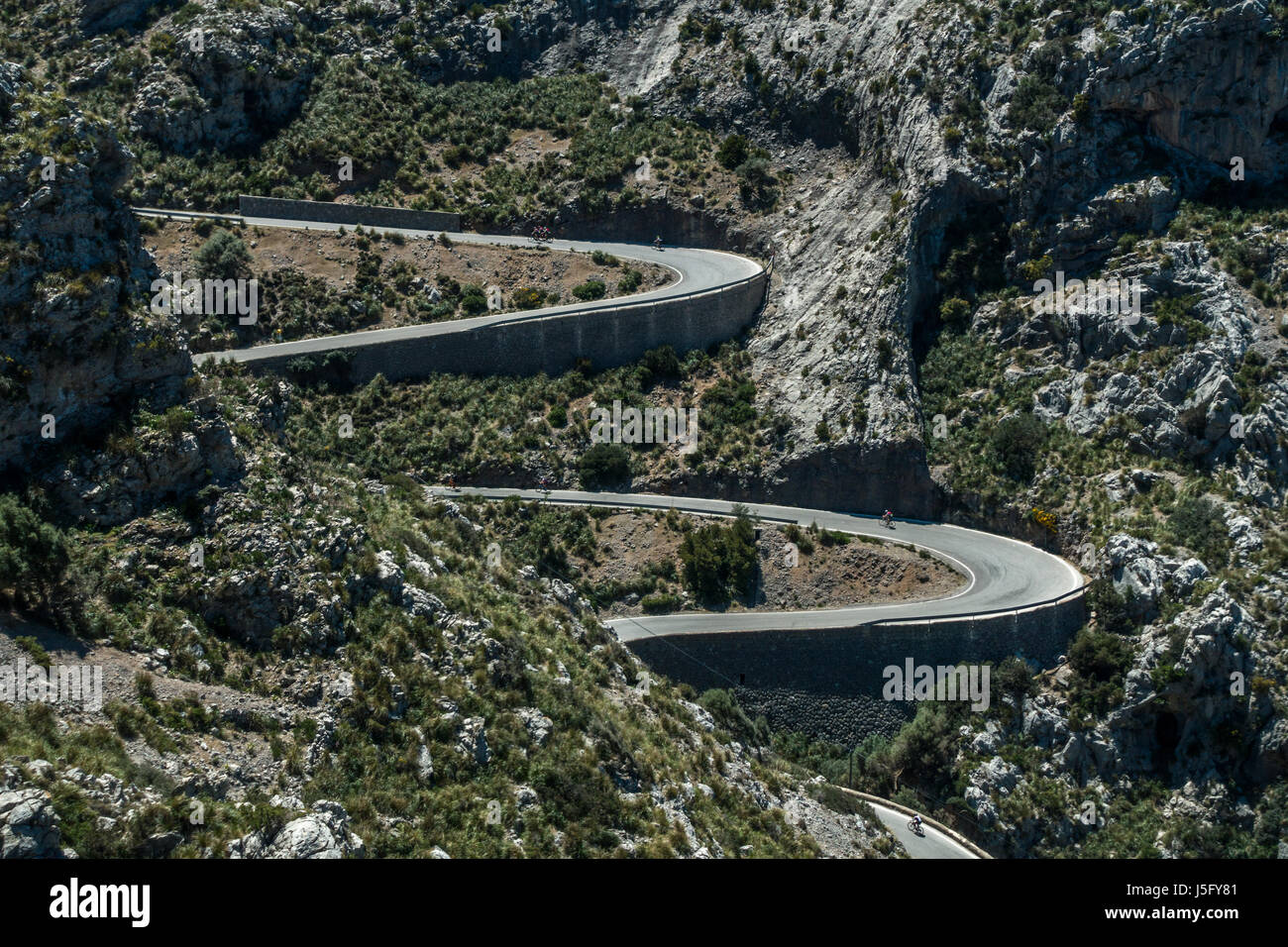 Cyclists on the famous winding road down to the coastal village of Sa Calobra, Mallorca, Majorca, Balearic Islands, - Stock Image