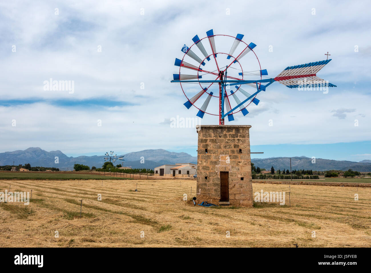 Old windmill used for farming in north Mallorca, Majorca, Balearic Islands, Spain - Stock Image