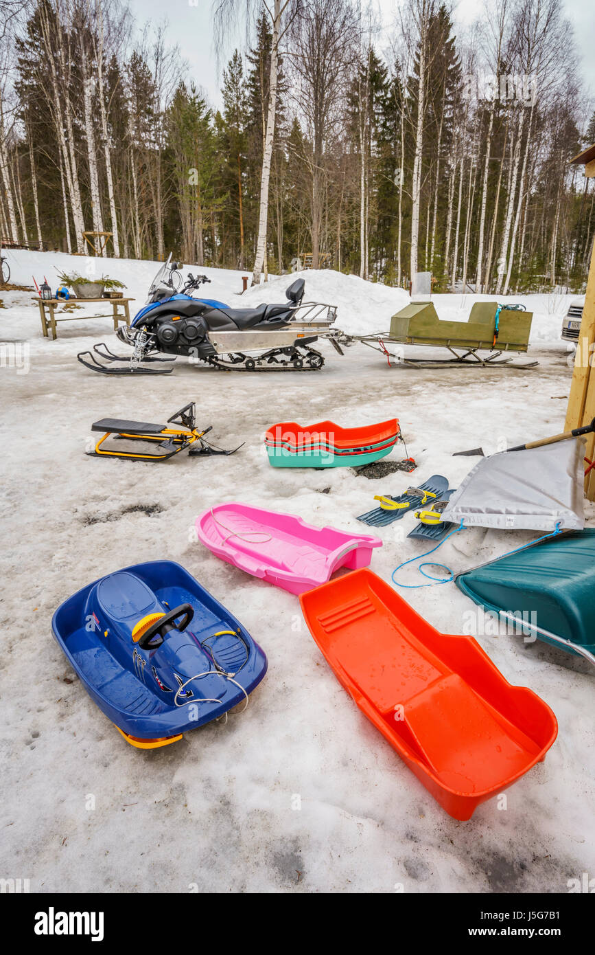 Snowmobiles and sleds, Lapland, Sweden - Stock Image