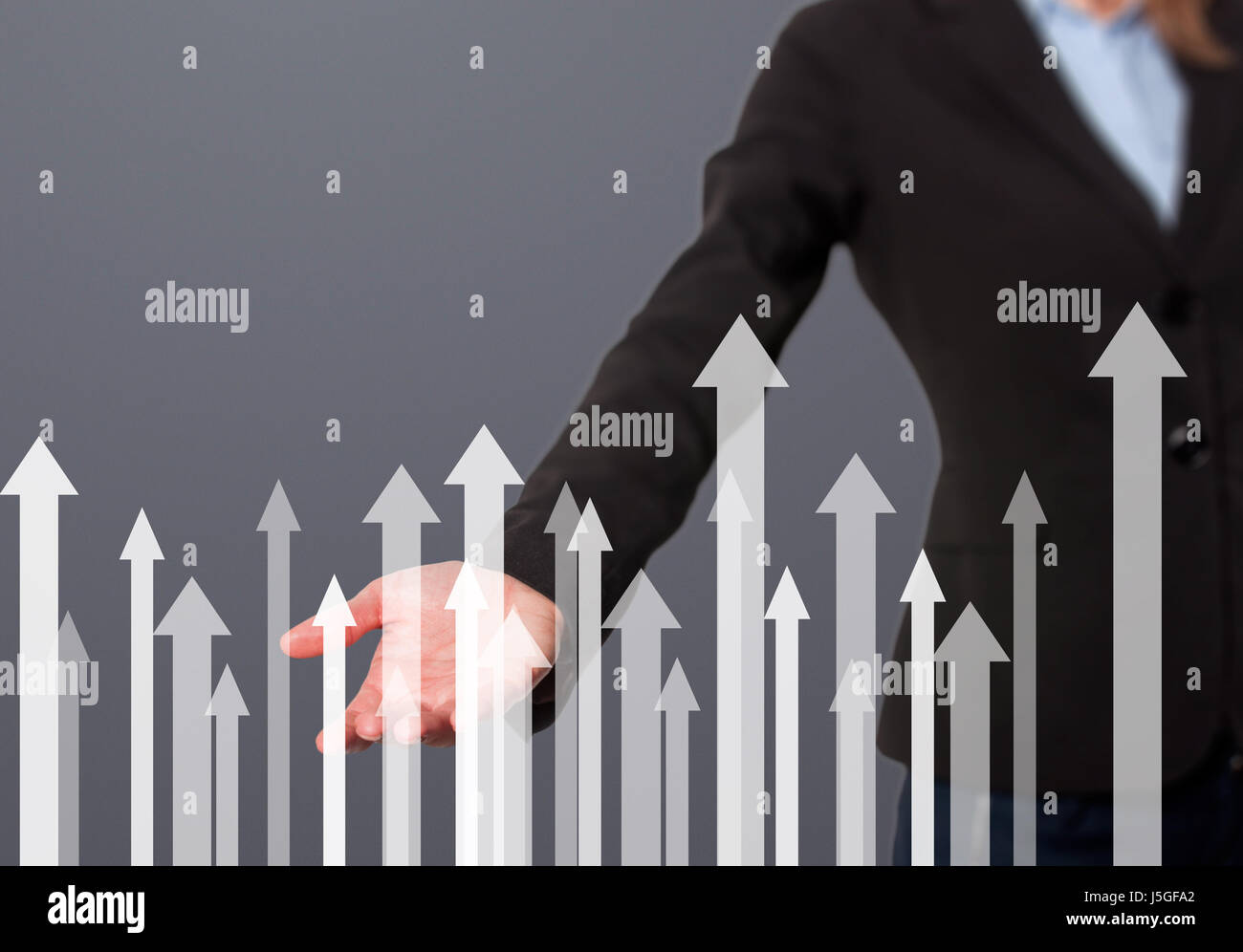 Businesswoman with financial symbols coming. Business, growth, investment concept. Women hand showing arrows. Isolated - Stock Image
