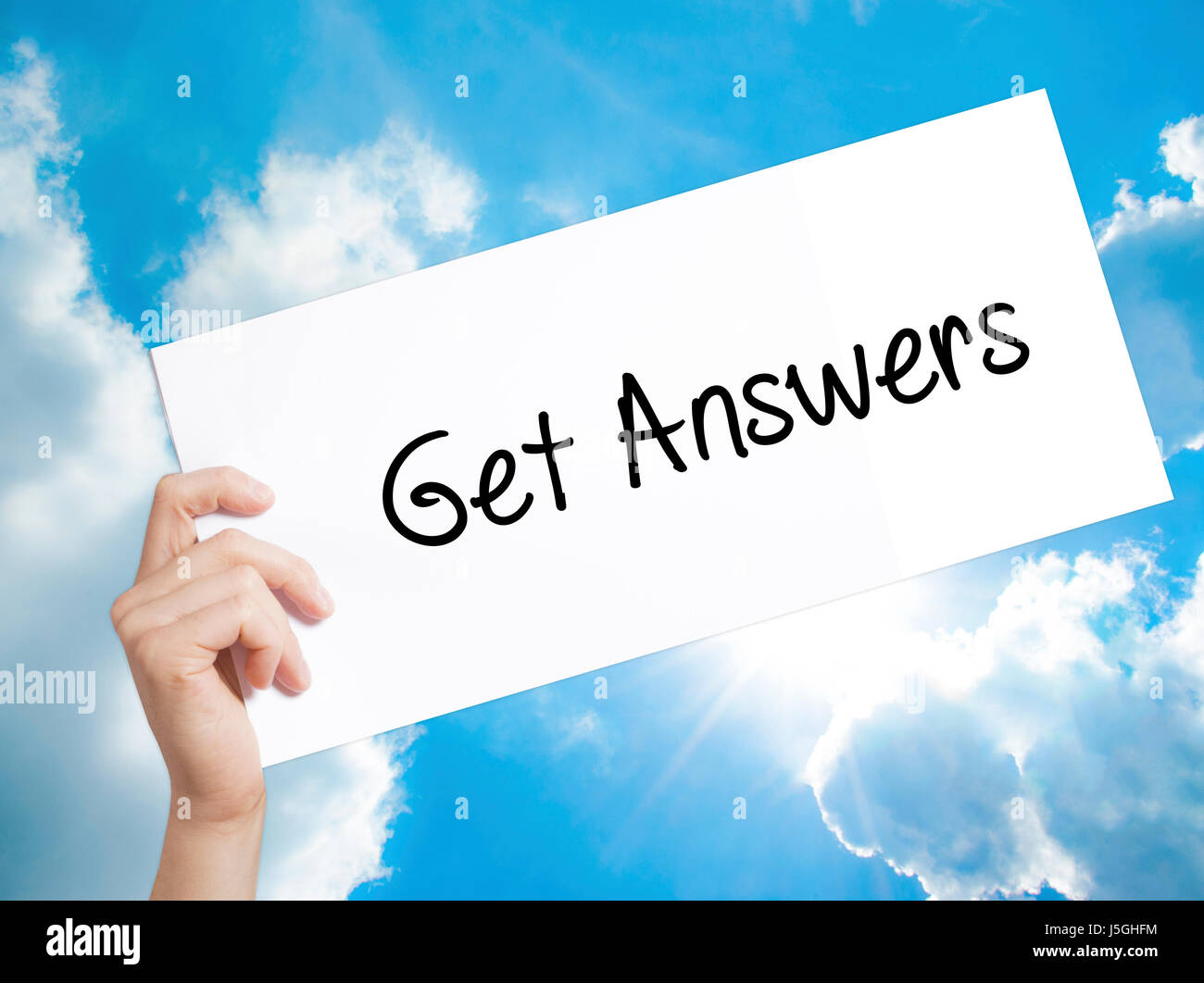 Get Answers Sign on white paper. Man Hand Holding Paper with text. Isolated on sky background.   Business concept. Stock Photo