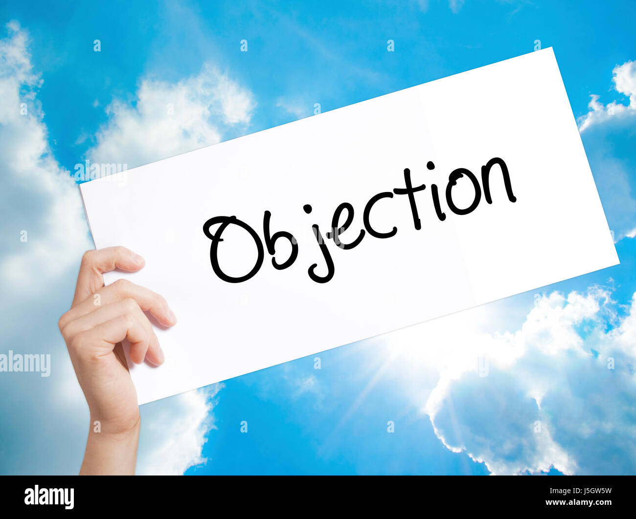 Objection Sign on white paper. Man Hand Holding Paper with text. Isolated on sky background.  Business concept. - Stock Image