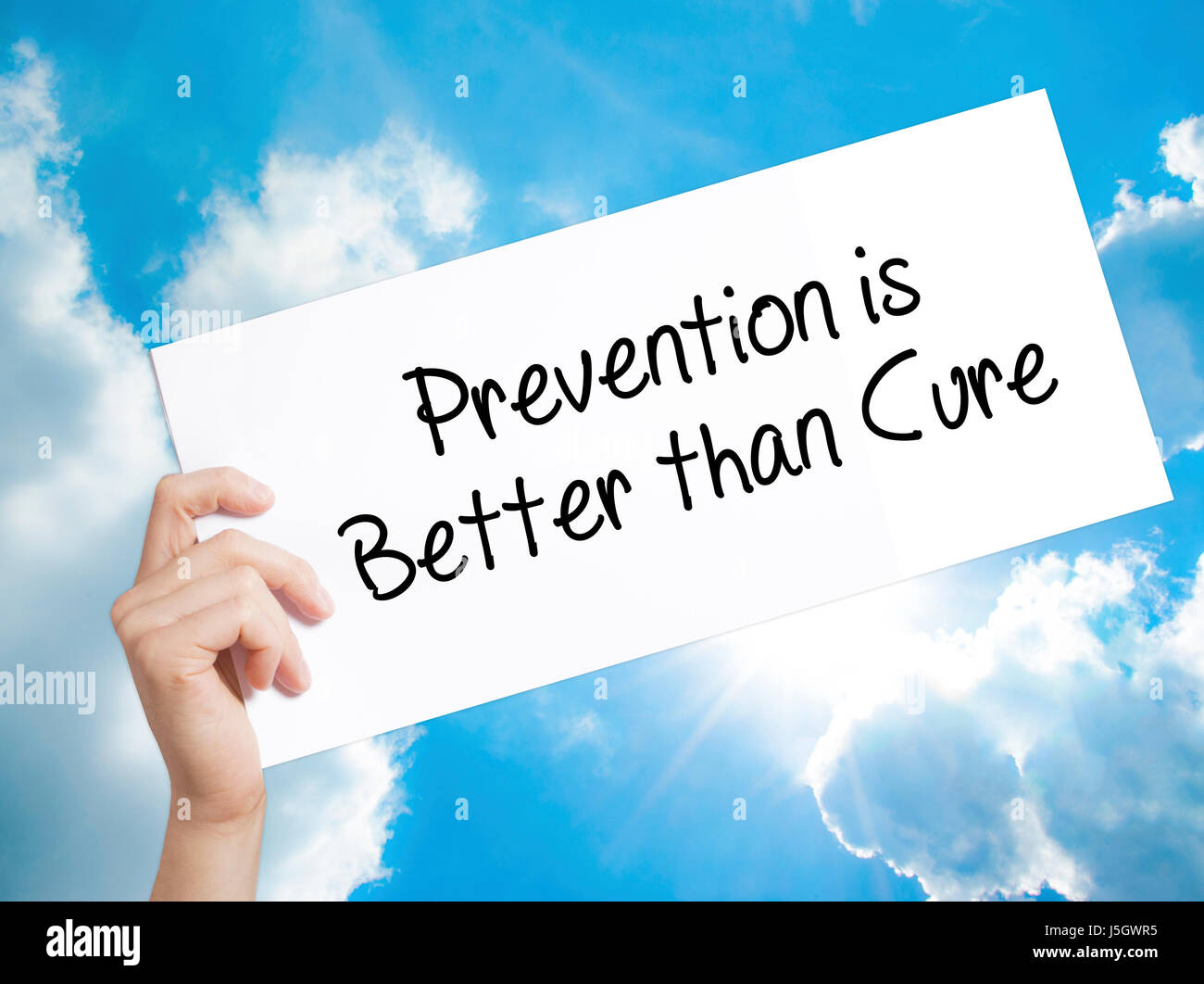 Prevention Is Better Than Cure Sign On White Paper Man Hand Holding