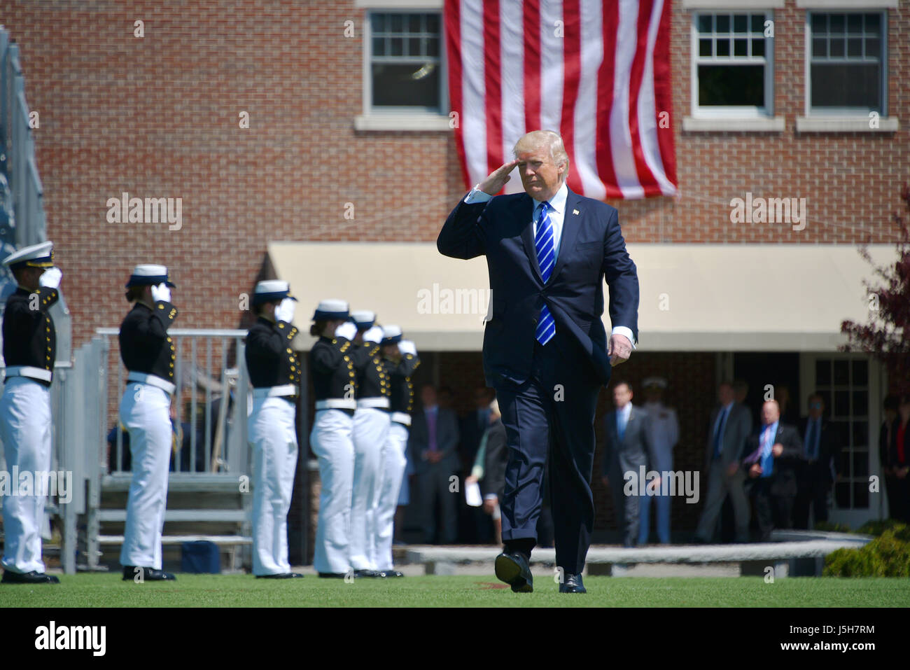 New London, USA. 17th May, 2017. U.S. President Donald Trump salutes as he arrives for the 136th Coast Guard Academy - Stock Image