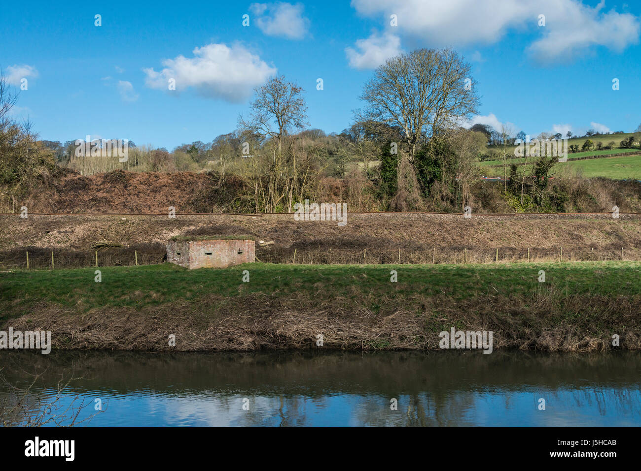 A World War two pillbox between the river Avon and the railway line near Avoncliff, Wiltshire - Stock Image