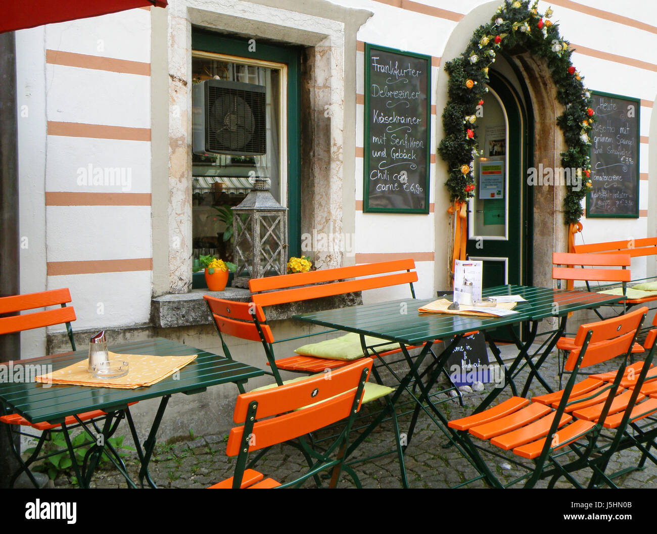 Vivid Orange Colored Outdoor Seating Of A Cozy Cafe