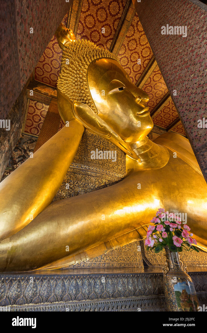 Torso of the famous Reclining Buddha statue at the Wat Pho (Po) temple complex in Bangkok, Thailand. - Stock Image