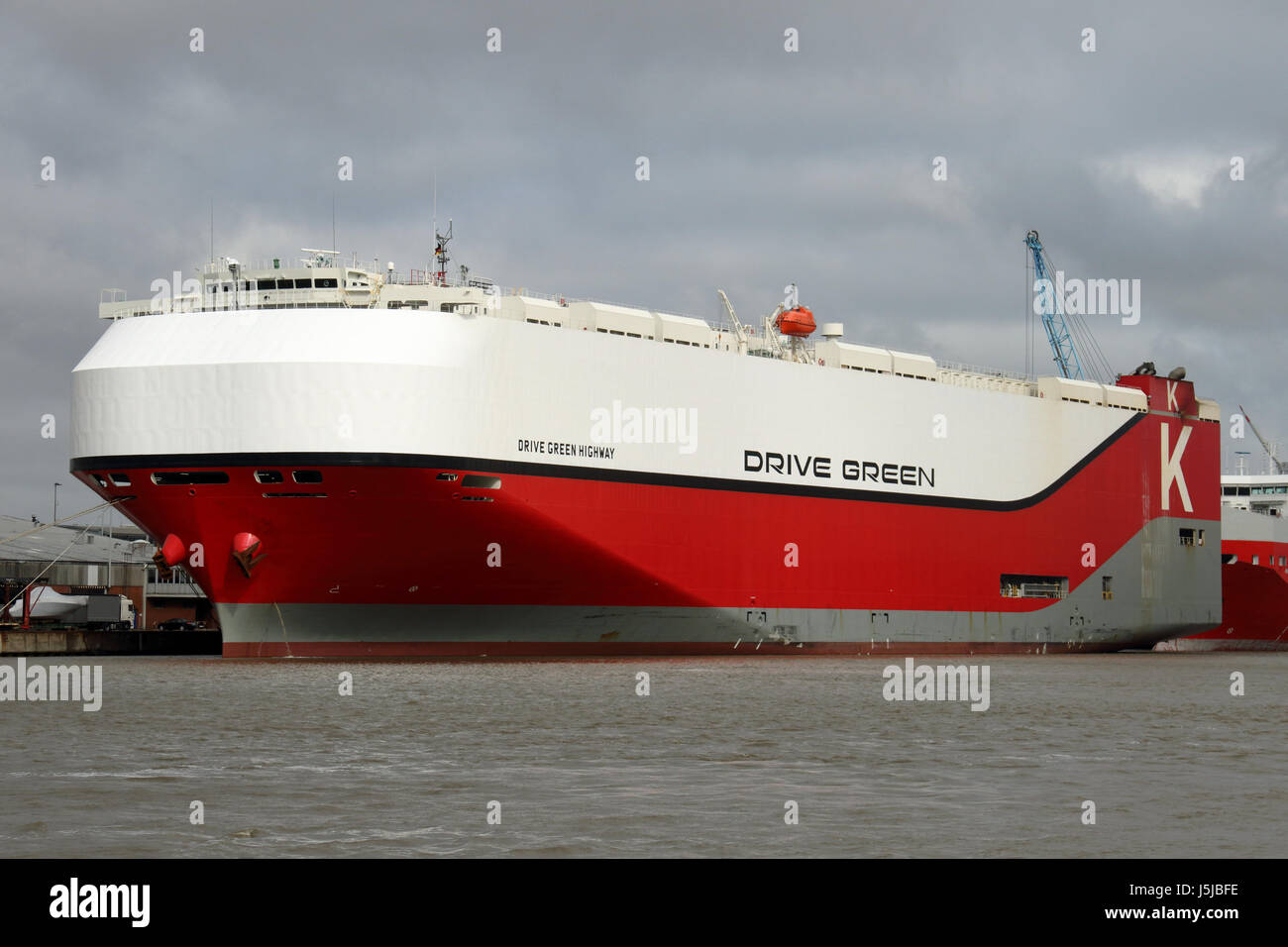 Car Carrier Drive Green Highway in Bremerhaven Stock Photo