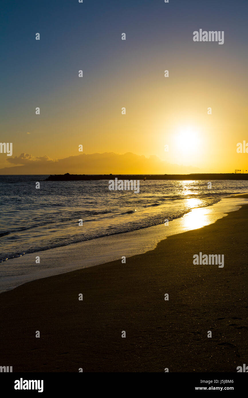 Sunset at Playa del Duque beach in Costa Adeje, Tenerife, Spain - Stock Image