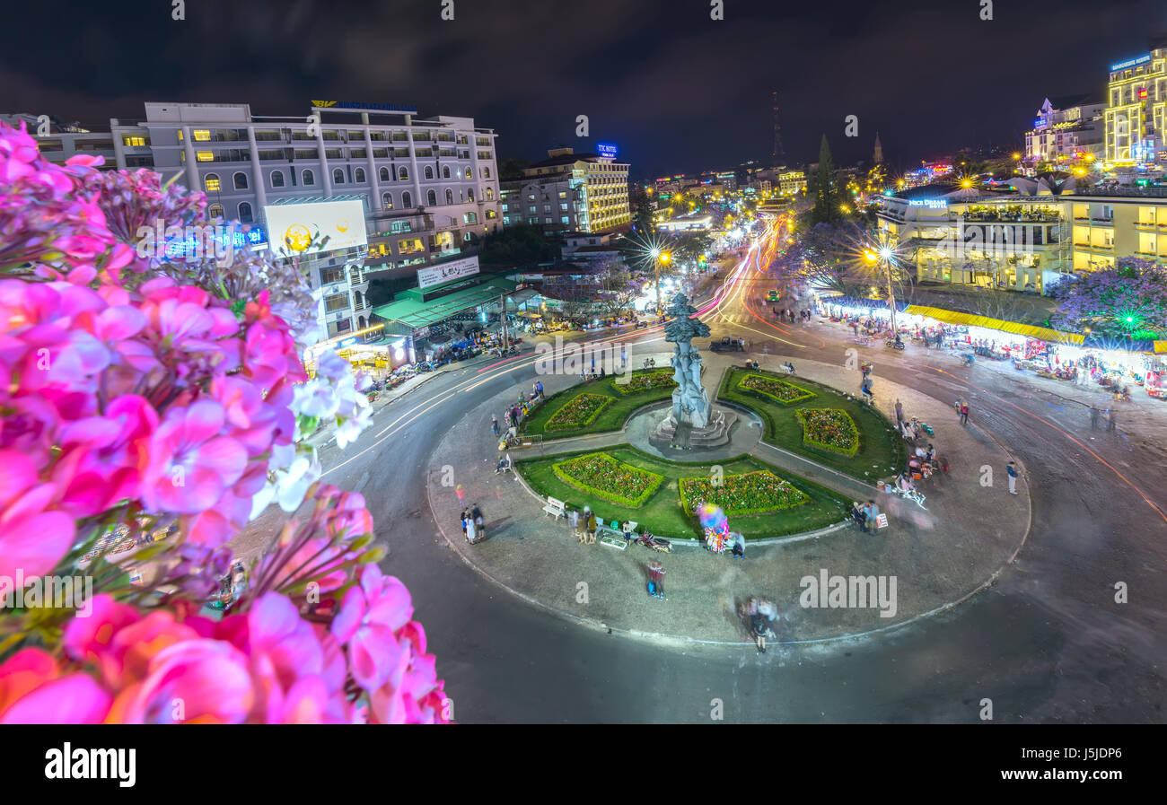 Dalat, Vietnam - March 28th, 2017: Roundabout intersections with lights Dalat night market, creating in streaks - Stock Image