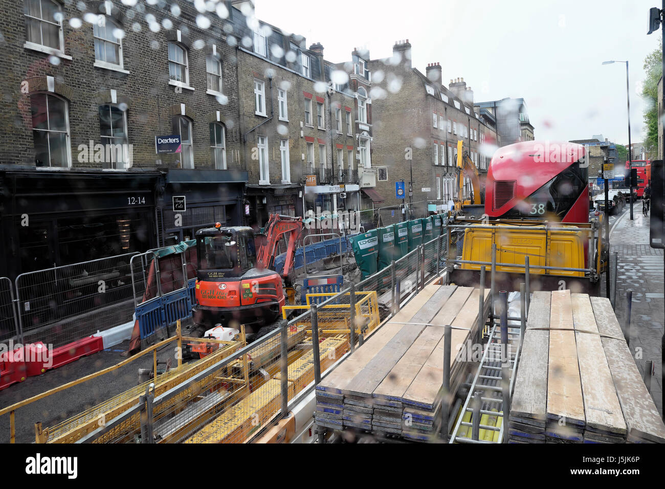 Construction lorry and double-decker bus in traffic congestion going to city centre on Essex Road near Islington - Stock Image