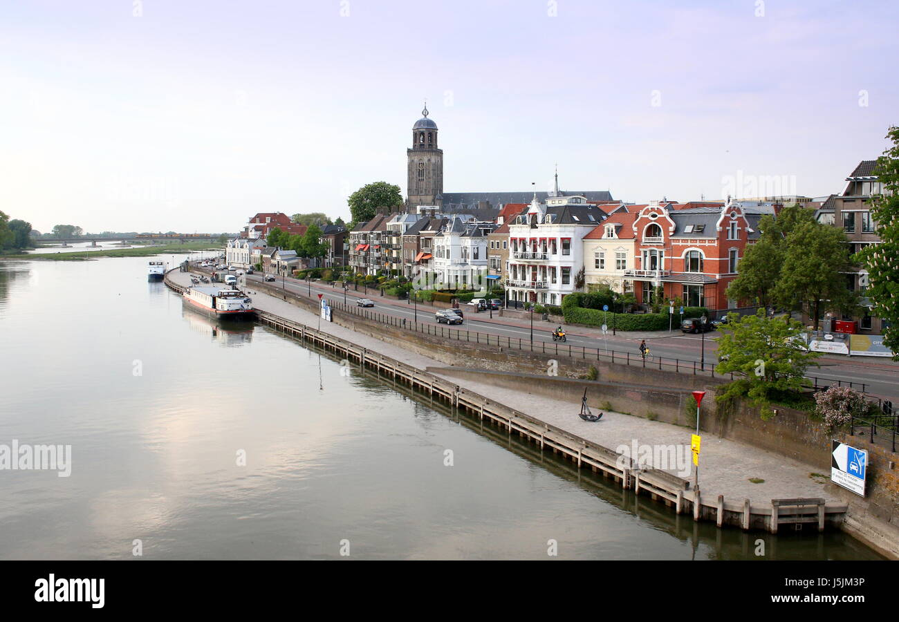Panorama of the IJssel River at Deventer, Netherlands. City skyline with St. Lebuinus Church (Grote or Lebuïnus Stock Photo