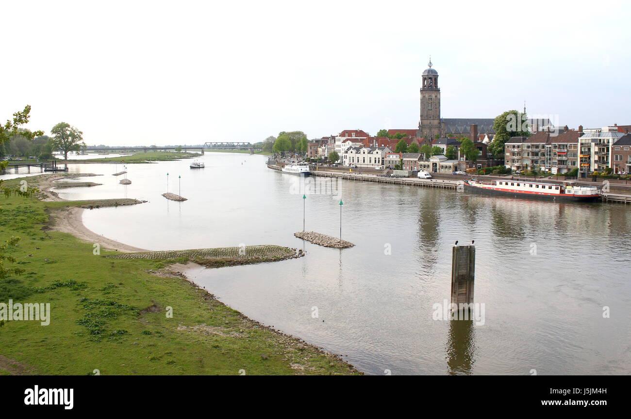 Panorama of IJssel River at Deventer, Netherlands. Skyline with St. Lebuinus Church (Grote Lebuïnus Kerk). River Stock Photo