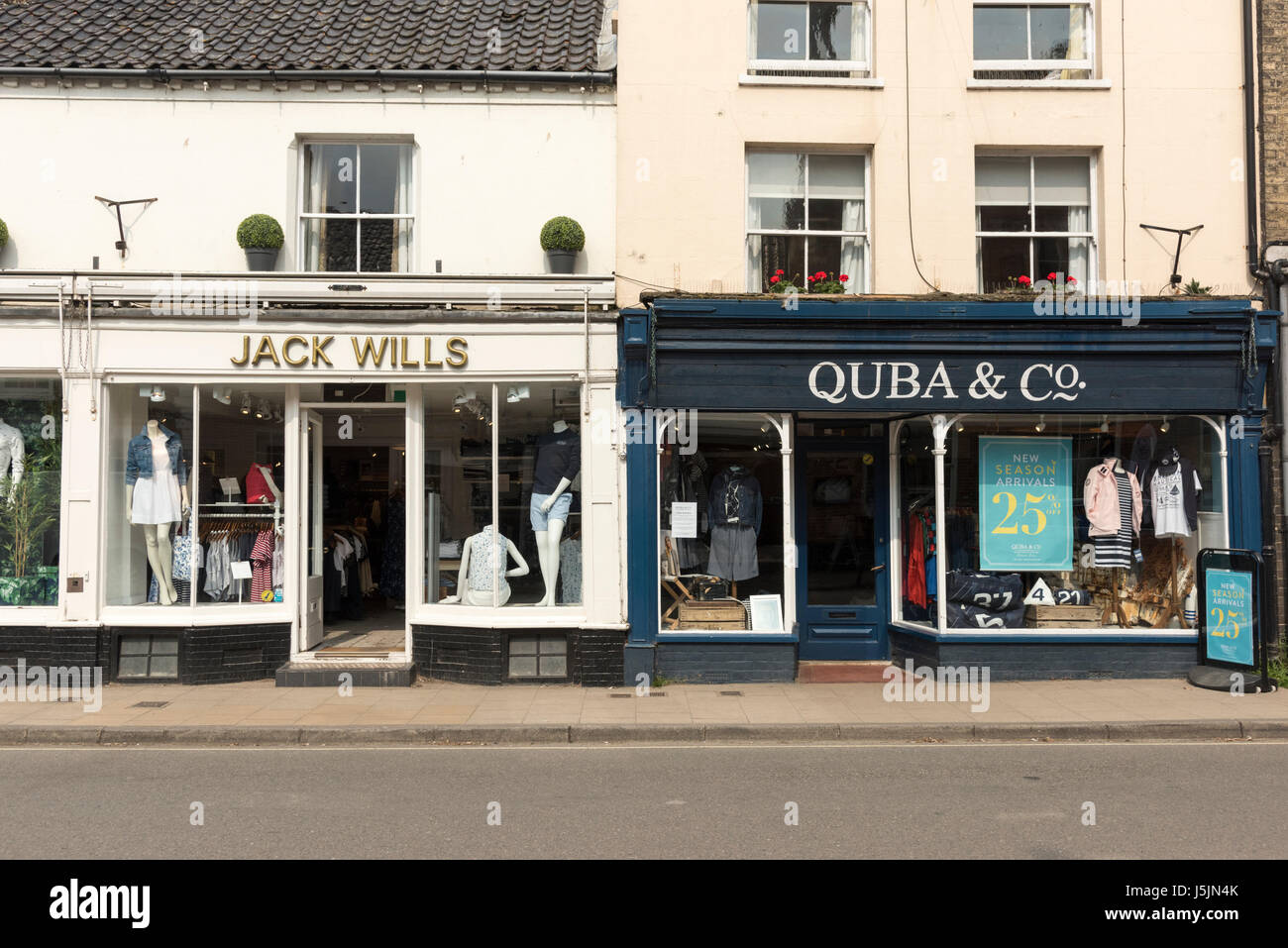 Jack Wills and Quba and co clothes shops next to each other in Southwold Suffolk UK - Stock Image
