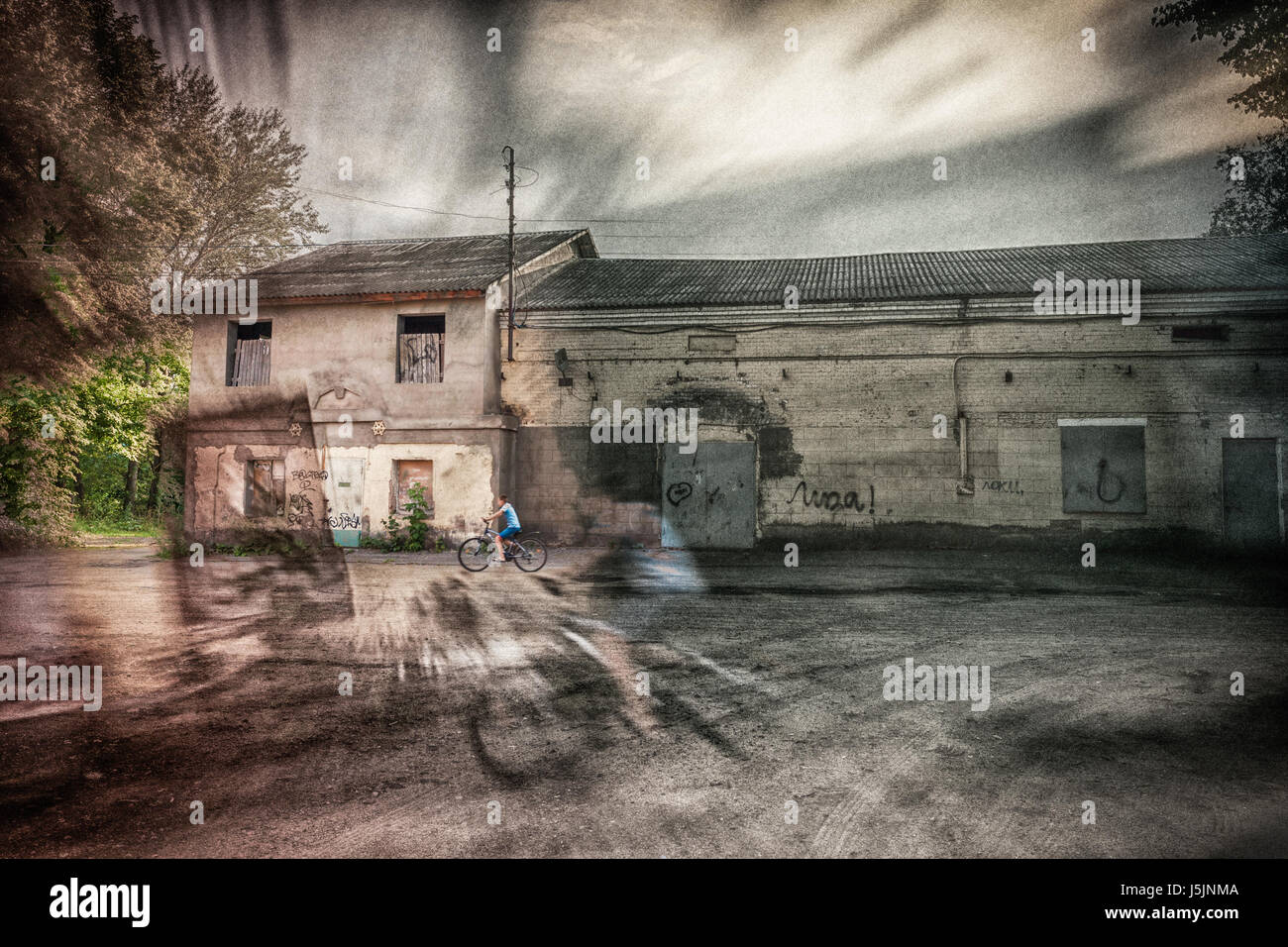 cyclists in the parallel worlds - Stock Image