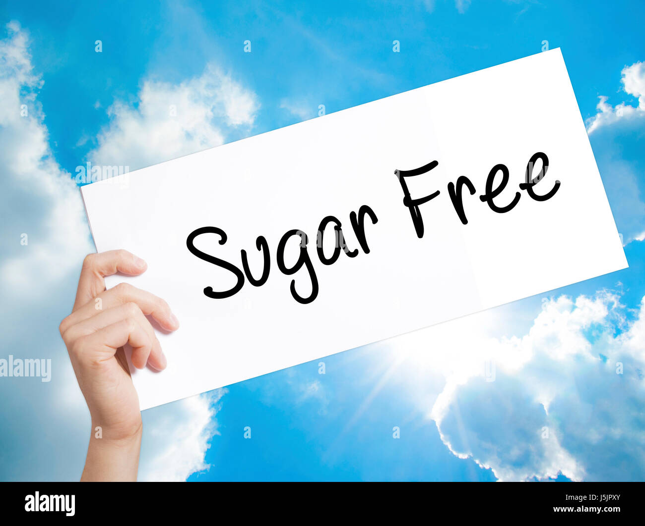 Sugar Free Sign on white paper. Man Hand Holding Paper with text. Isolated on sky background.   Business concept. - Stock Image