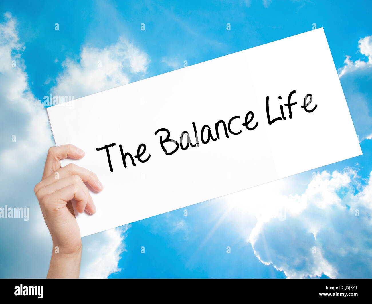 the balance life sign on white paper man hand holding paper with
