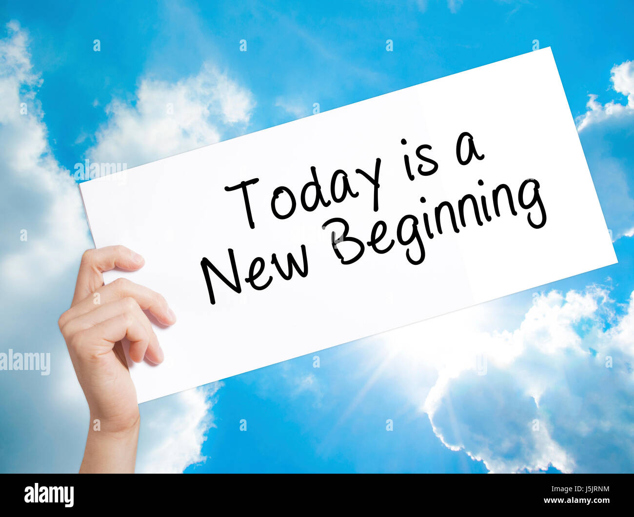 e6300f5838ee Today is a New Beginning Sign on white paper. Man Hand Holding Paper with  text. Isolated on sky background. Business concept. Stock Photo