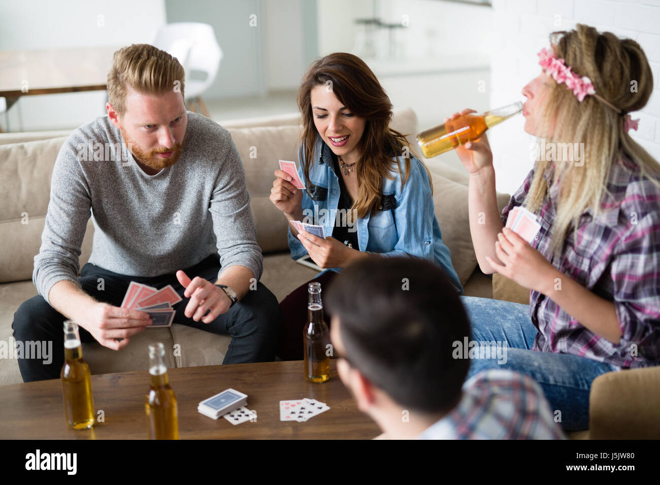 Friends having fun and smiling together indoors - Stock Image
