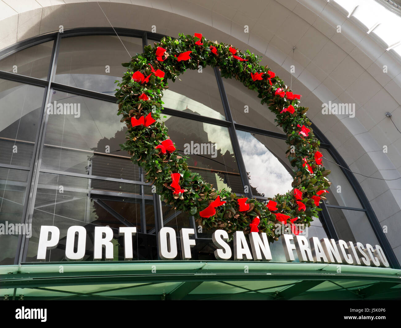 Thanksgiving / Christmas wreath on entrance to Port of San Francisco embarcation piers Embarcadero California USA - Stock Image