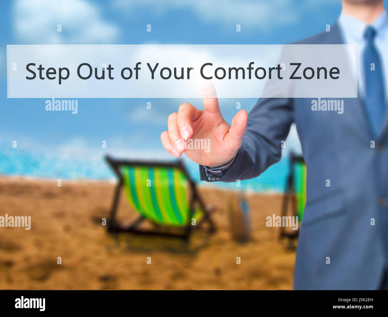 Step Out of Your Comfort Zone - Businessman hand pressing button on touch screen interface. Business, technology, internet concept. Stock Photo Stock Photo