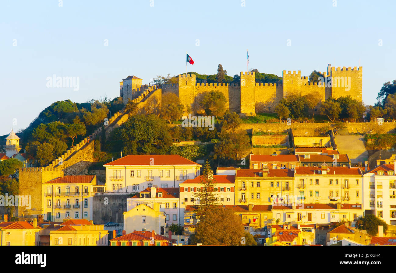 Lisbon Castle on a top of a hill at sunset. Lisbon, Portugal - Stock Image