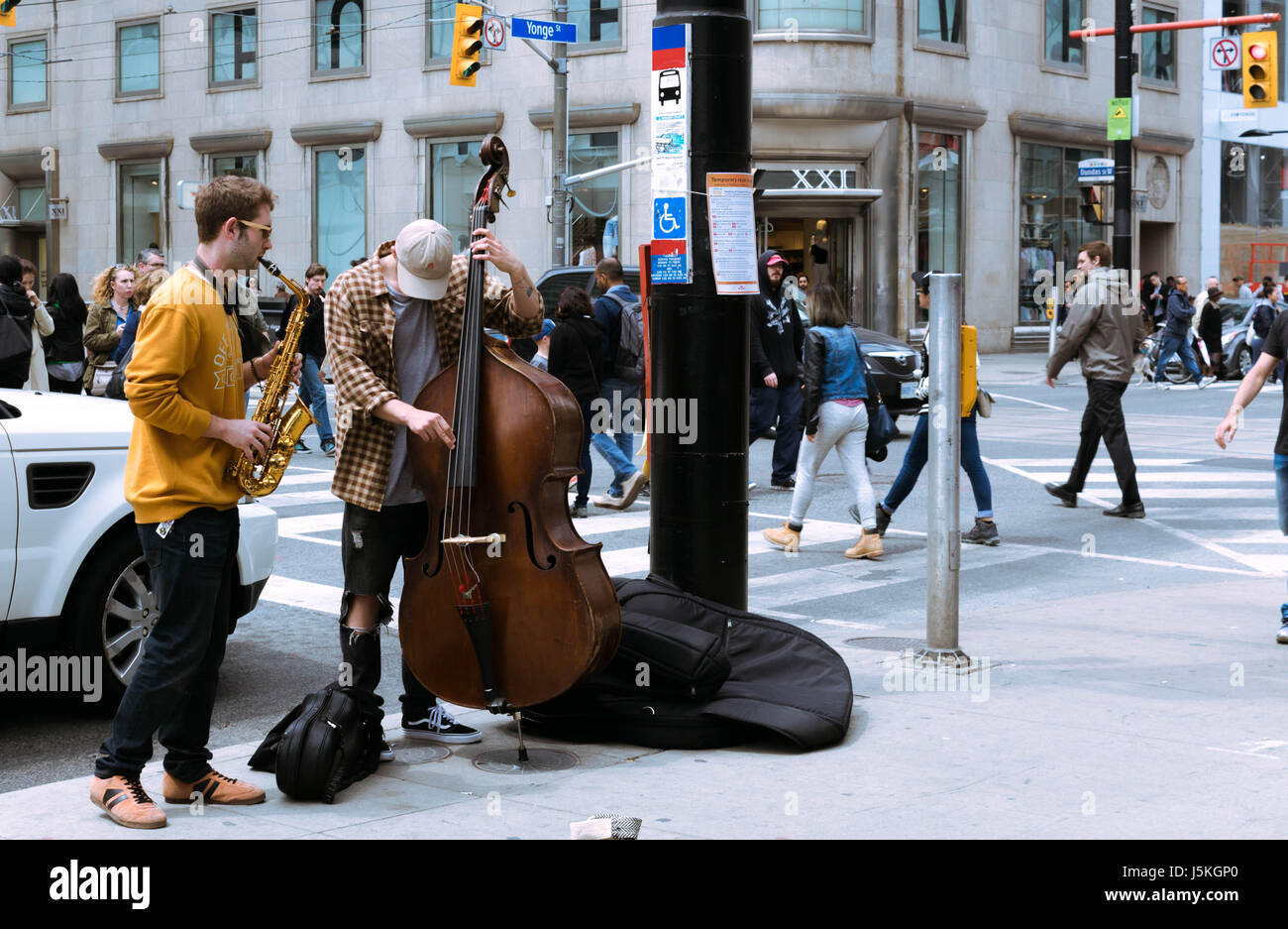 Two musicians performing in Eaton Centre in Toronto - Stock Image