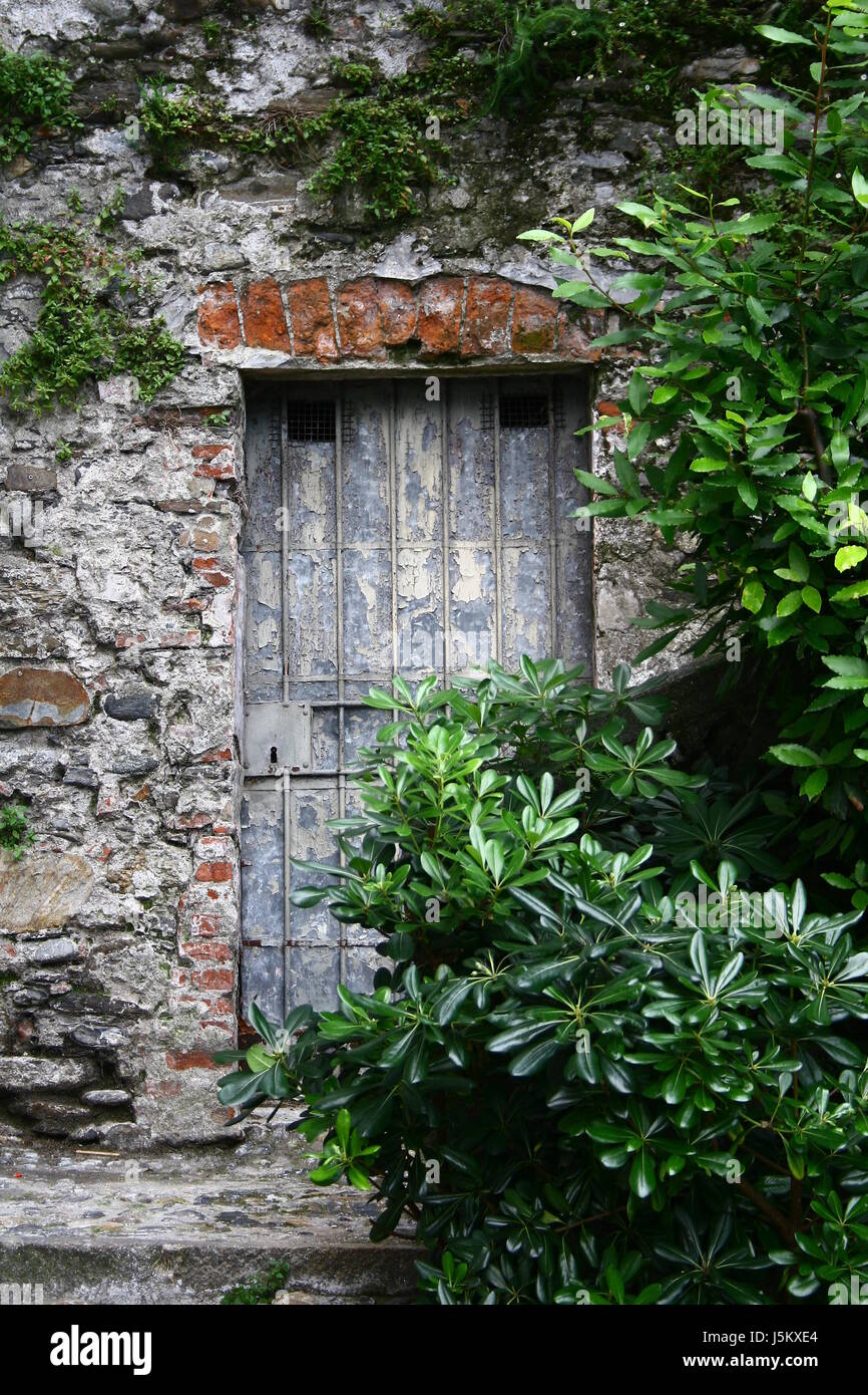 stone door wall closed metal ruins coalesce forget lacquer
