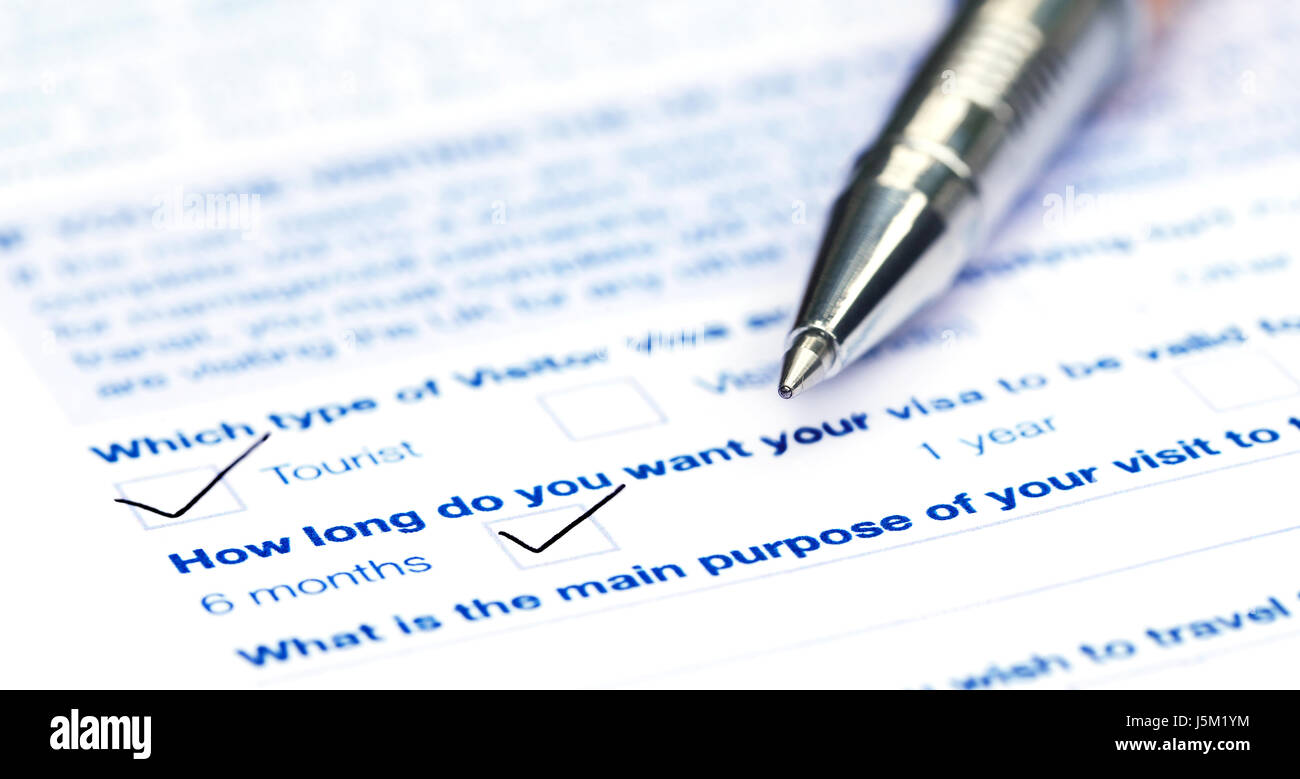 Visa application form with a ballpoint Stock Photo