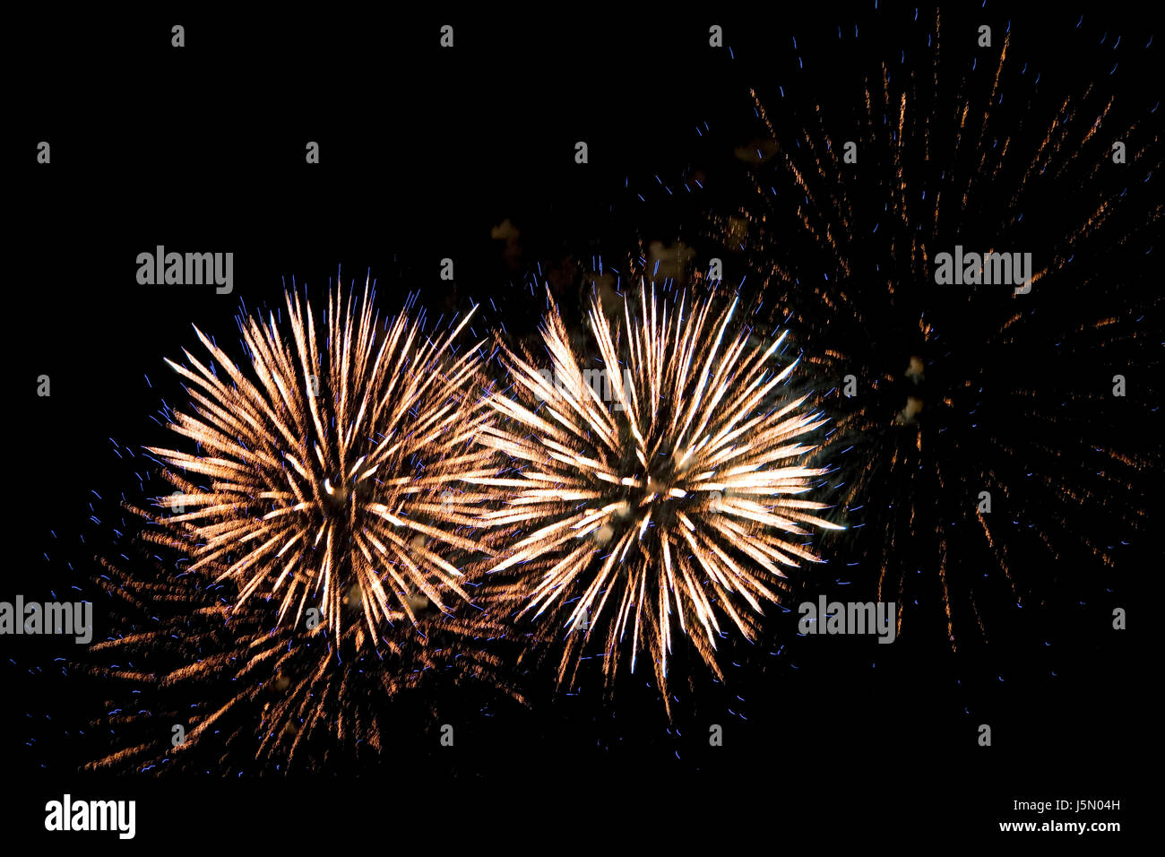 party celebration rockets silvester saluting gun clacker firecracker firework - Stock Image