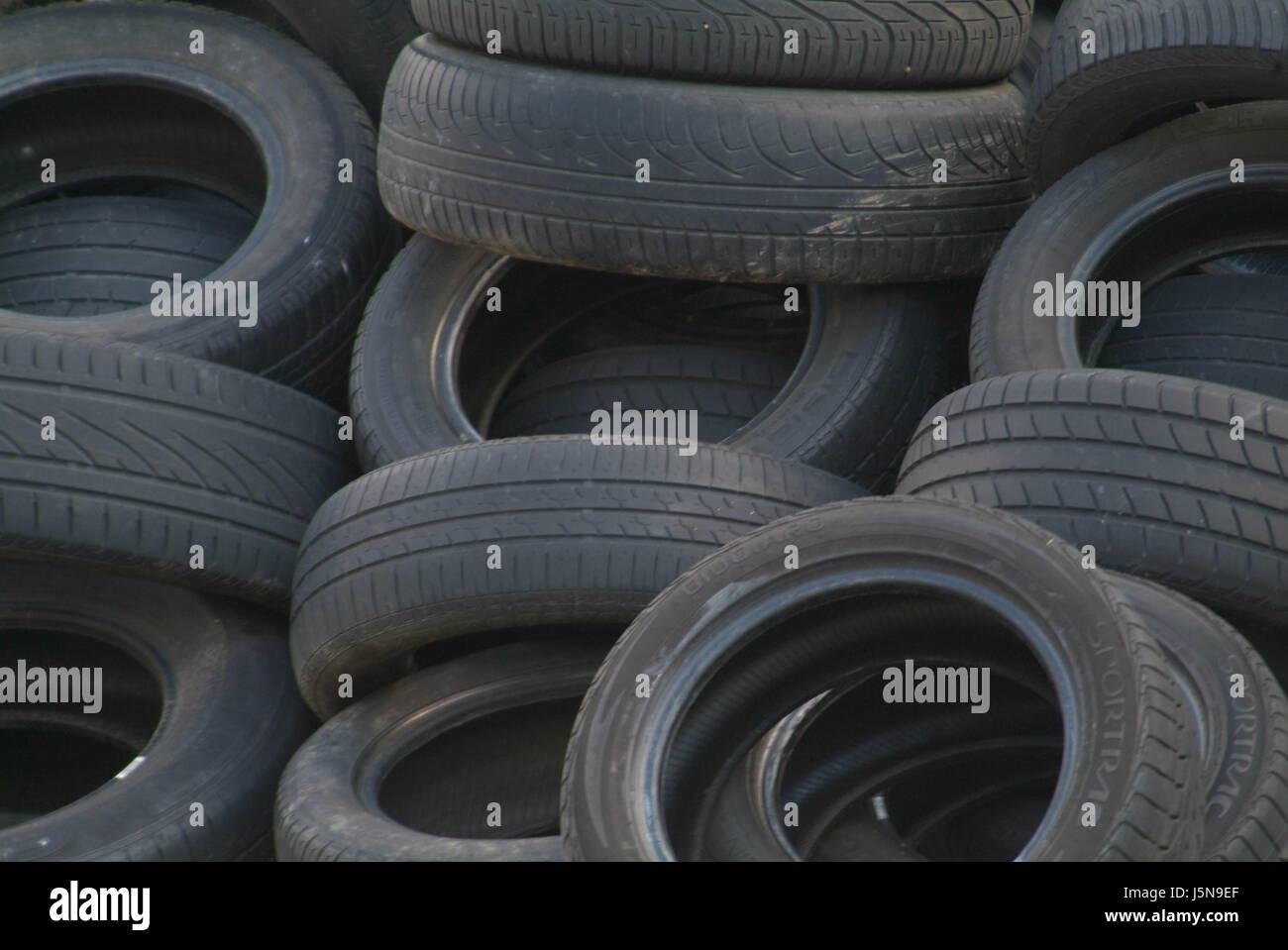 trash stack scrap disposal mull refuse car tire skedaddle heap pile