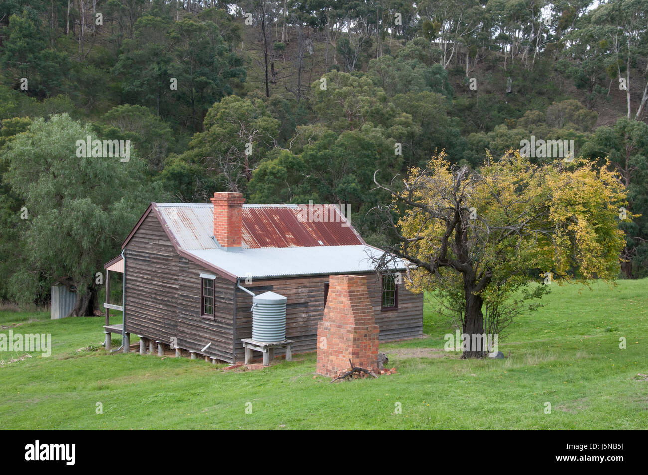 Blacksmith's cottage and ruined smithy in the ghost town of Steiglitz in the Brisbane Ranges, Victoria, Australia - Stock Image