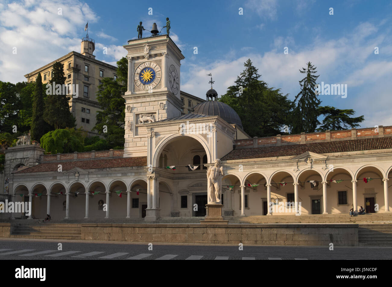 Udine: Piazza Libertà, the oldest square of the town. View of the castle, bell tower and St. John's Loggia - Stock Image