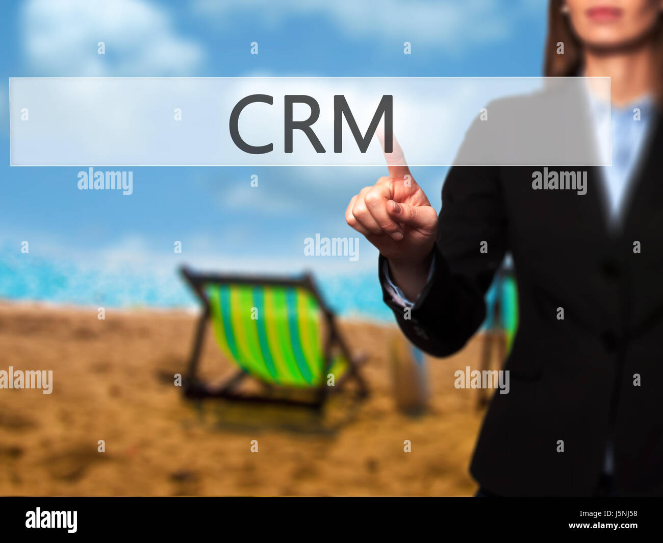 CRM -  Female touching virtual button. Business, internet concept. Stock Photo - Stock Image
