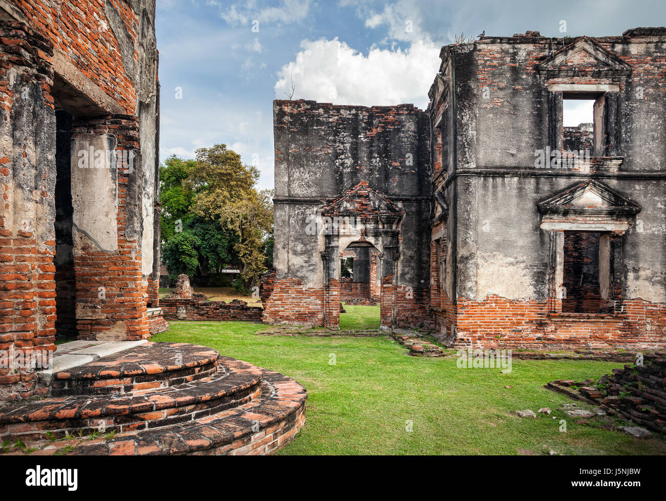 Ancient ruined Temple in Lopburi at overcast sky, Thailand - Stock Image