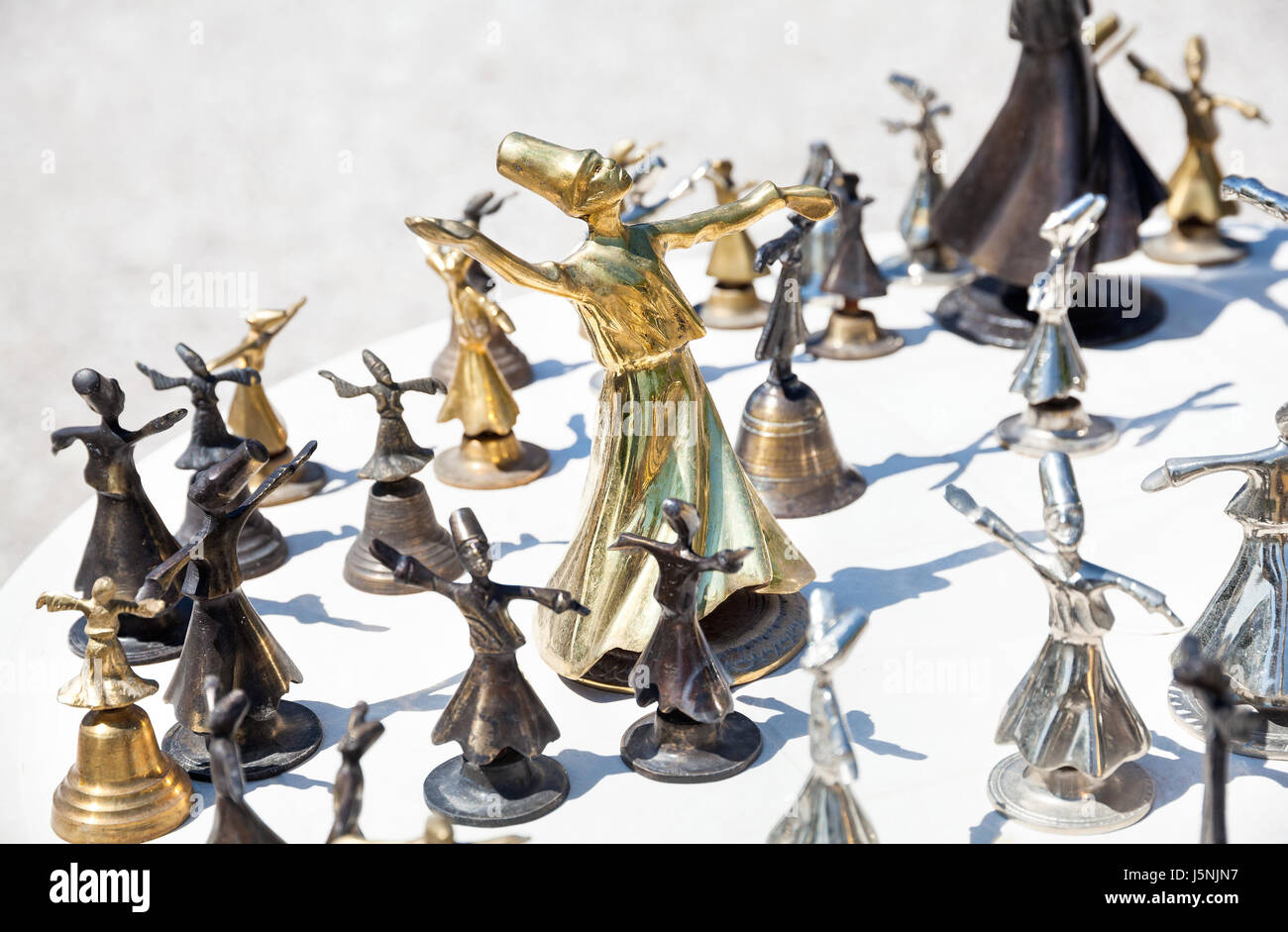 Souvenir of whirling Sufi from metal in the shop, Turkey - Stock Image