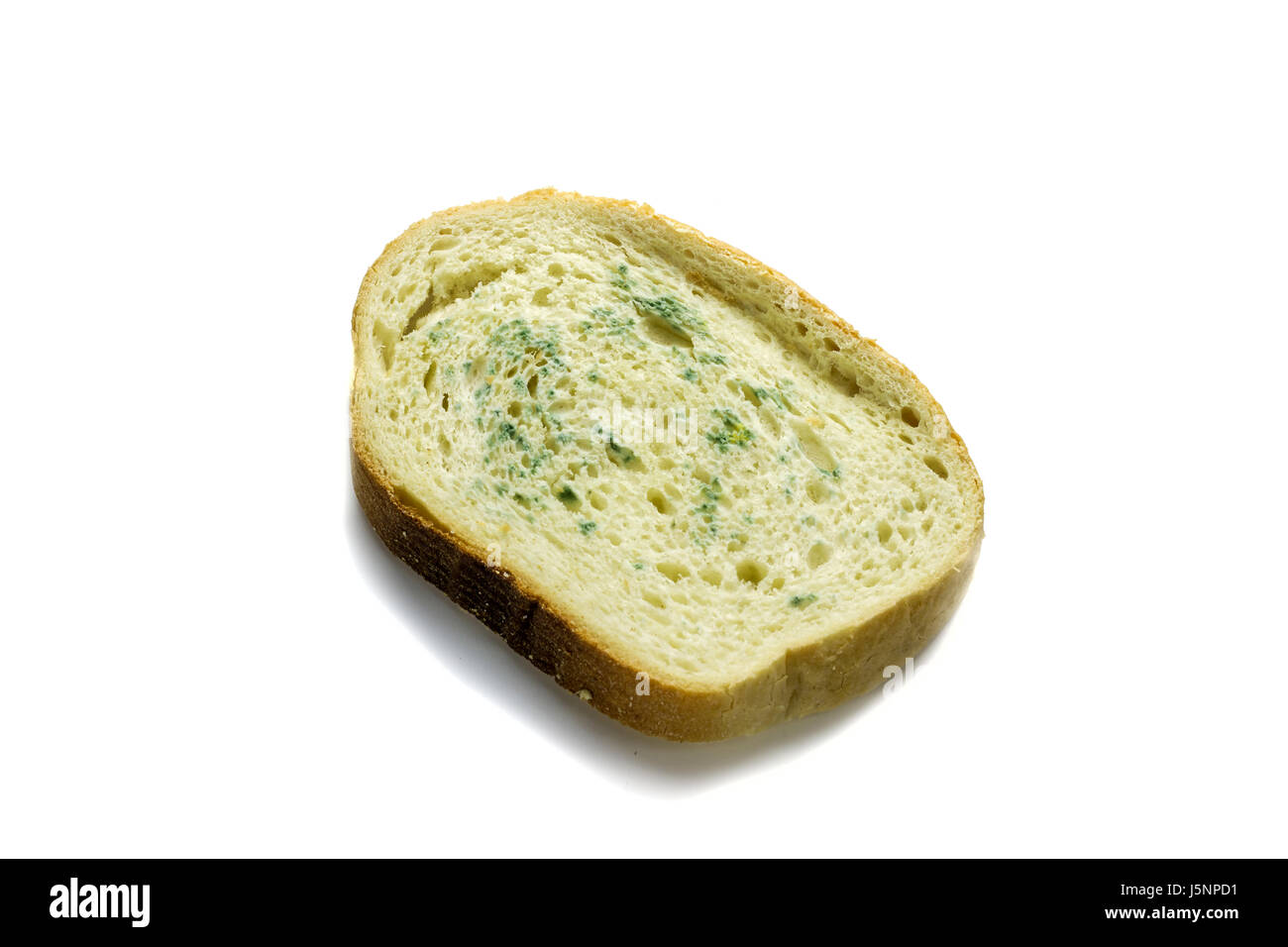 Spoiled bread with a mold on a white background. - Stock Image