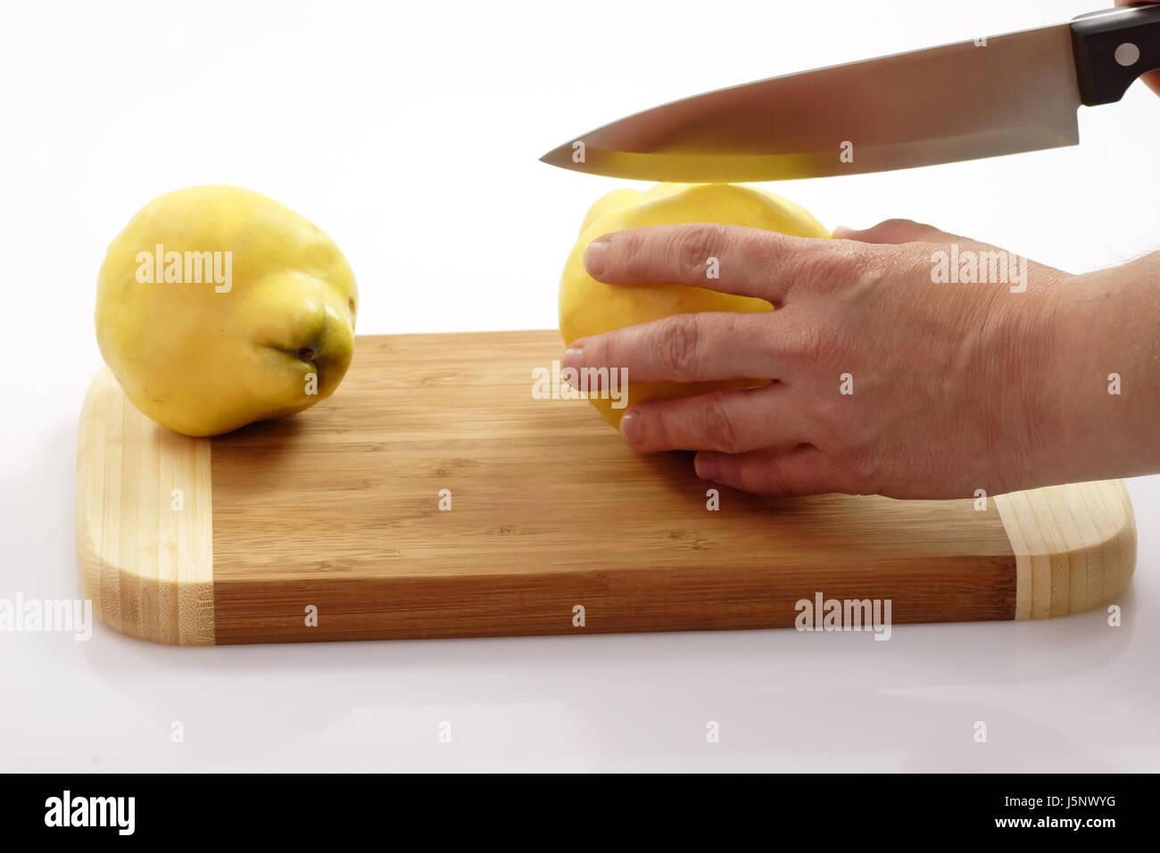 hand pome fruit quinces jam cut jelly season medicinal plant liqueur carving Stock Photo